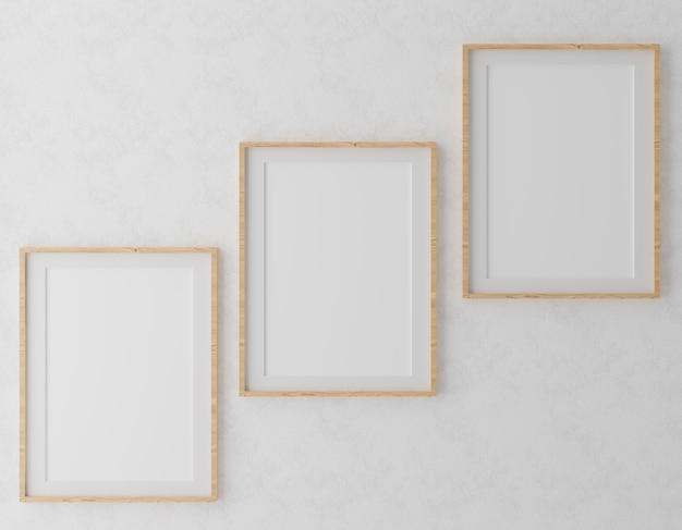 Drei vertikale holzrahmen auf weißer wand