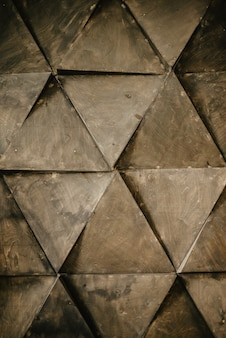 Dreieckiger abstrakter hintergrund, grunge wandfläche