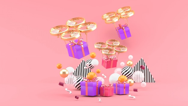 Drohne liefert eine geschenkbox zwischen bunten kugeln auf rosa. 3d rendern