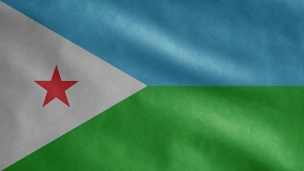 Dschibuti-flagge, die im wind weht. dschibuti schablone weht, weiche und glatte seide. stoff stoff textur fähnrich hintergrund.