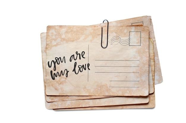 Du bist meine liebe. schriftzug auf einer vintage-postkarte. getrennt auf weiß.