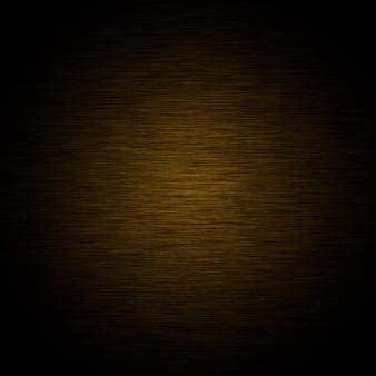 Dunkel gebürstete gelbe und schwarze metallische textur oder hintergrund
