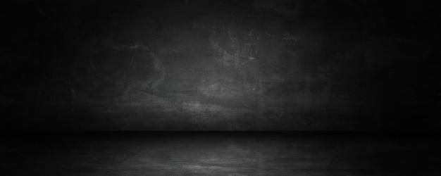 Dunkel-schwarzes studio und ausstellungsraum für aktuelle produkte