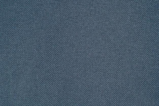 Dunkelblaue gewebebeschaffenheit des stoffes, der strukturell textilgewebe ist, fasert hintergrund