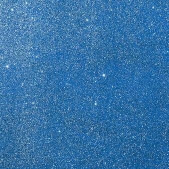 Dunkelblaue glitzernde texturhintergrundabstraktion