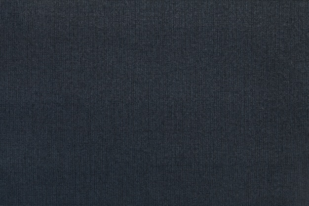 Dunkelblauer hintergrund von einem textilmaterial