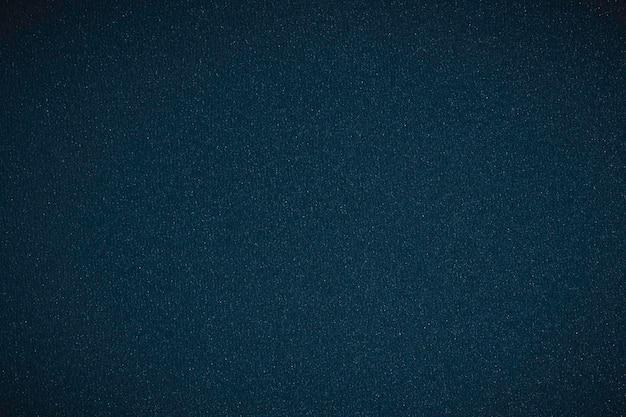 Dunkelblauer marmoroberflächenhintergrund mit vignette