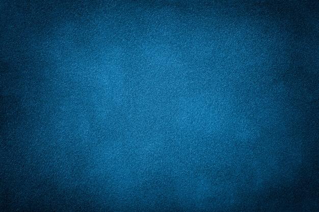 Dunkelblauer matter hintergrund des veloursledergewebes