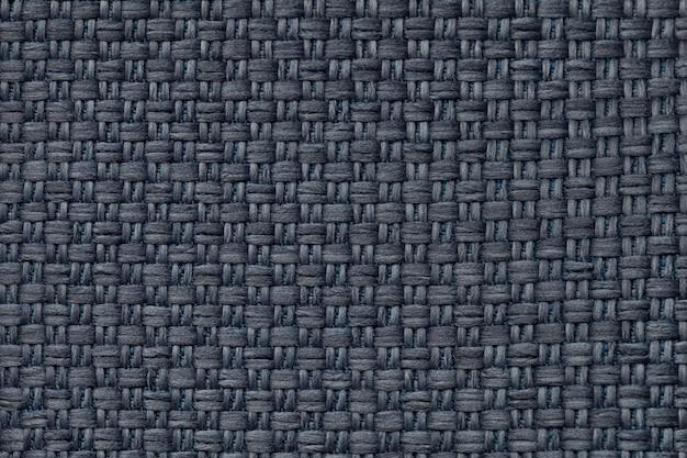 Dunkelblauer textilhintergrund mit kariertem muster, nahaufnahme. struktur des gewebemakros.