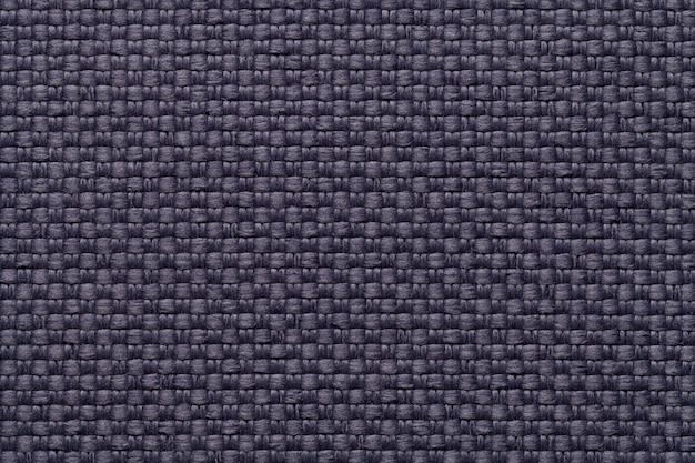Dunkelblauer textilhintergrund mit kariertem muster, nahaufnahme struktur des gewebemakros