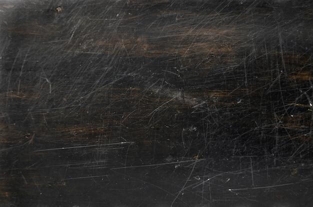 Dunkelbraune verkratzte hölzerne beschaffenheit, hintergrund mit kopienraum. banner