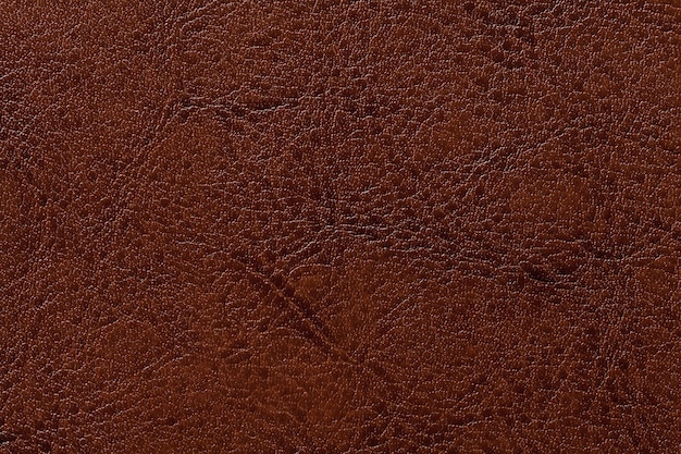 Dunkelbrauner lederner beschaffenheitshintergrund, nahaufnahme. gebrochener bronzehintergrund von der faltenhaut