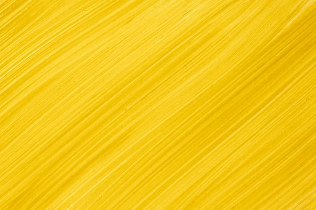 Dunkelgelbe farbe des abstrakten flüssigen kunsthintergrundes. flüssiger marmor. acrylmalerei auf leinwand mit goldenem farbverlauf. aquarellhintergrund mit bernsteinfarbenem streifenmuster. steintapete.