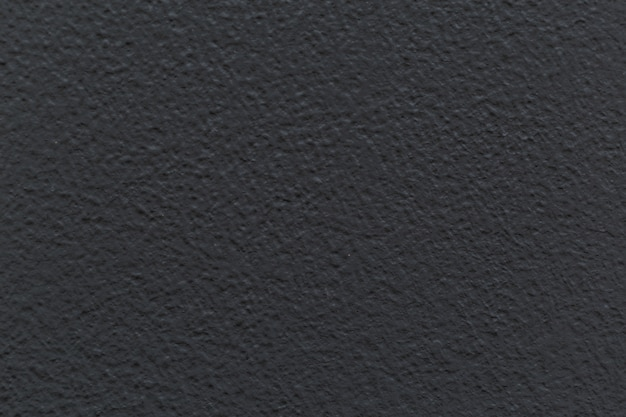 Dunkelgraue betonmauer mit schmutzigem hintergrund - bild.