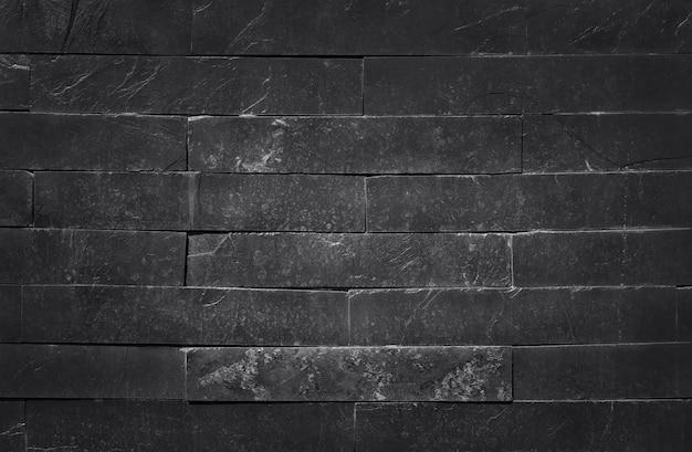 Dunkelgraue schwarze schieferbeschaffenheit mit hoher auflösung, oberfläche der steinbacksteinmauer für hintergrund