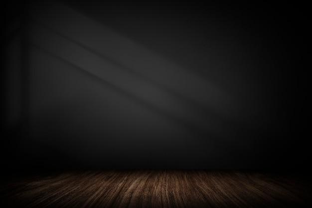 Dunkelgraue wand mit holzbrett-produkthintergrund