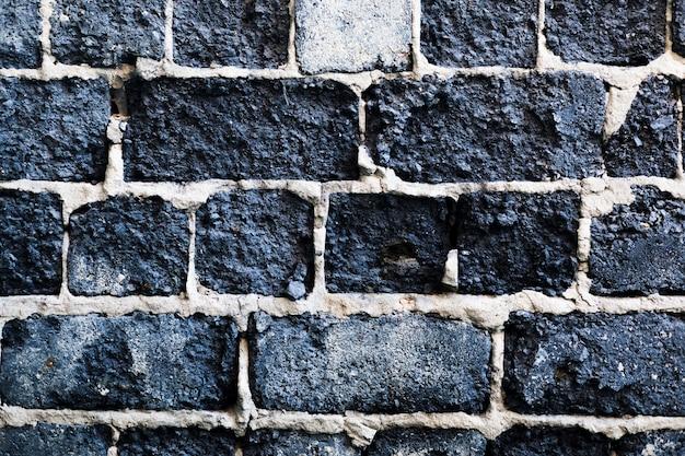 Dunkelgrauer grunge stonewall hintergrund