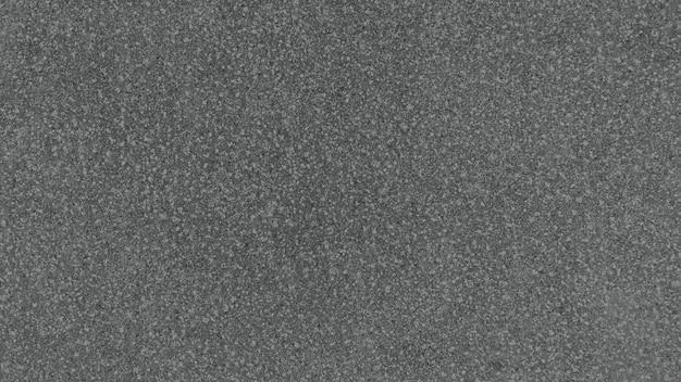 Dunkelgrauer korntexturhintergrund