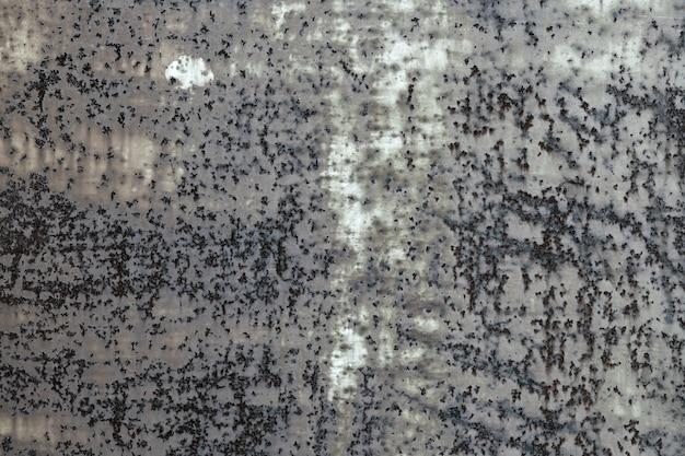 Dunkelgrauer rostiger metallbeschaffenheitshintergrund. vintage-effekt.