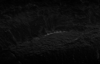Dunkelgrauer schwarzer Schieferhintergrund