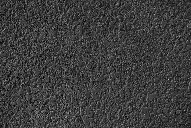 Dunkelgrauer strukturierter betonhintergrund