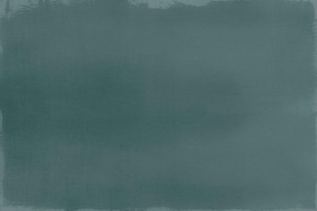 Dunkelgrüne farbe auf einem strukturierten leinwandhintergrund
