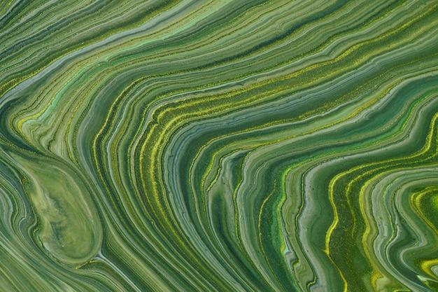Dunkelgrüne glitzerfarben des abstrakten fließenden kunsthintergrunds. flüssiger marmor. acrylmalerei auf leinwand mit olivgrünem farbverlauf