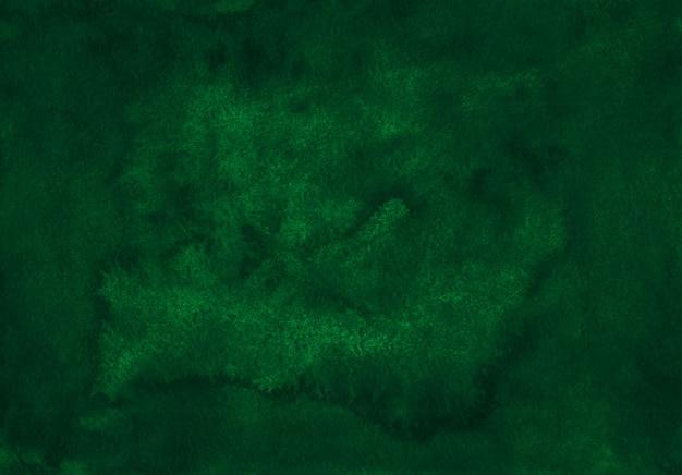 Dunkelgrüne hintergrundbeschaffenheit des aquarells. aquarell abstrakter tiefer fichtenhintergrund. flecken auf papier.