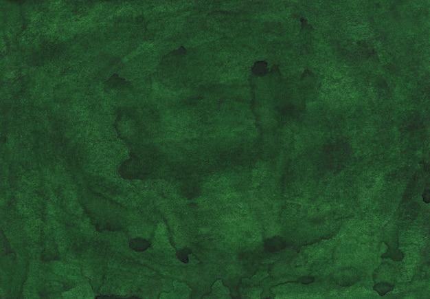 Dunkelgrüne hintergrundmalerei des aquarells. aquarelle tiefgrasgrüne farbe. pinselstriche auf handgemalter papierstruktur.