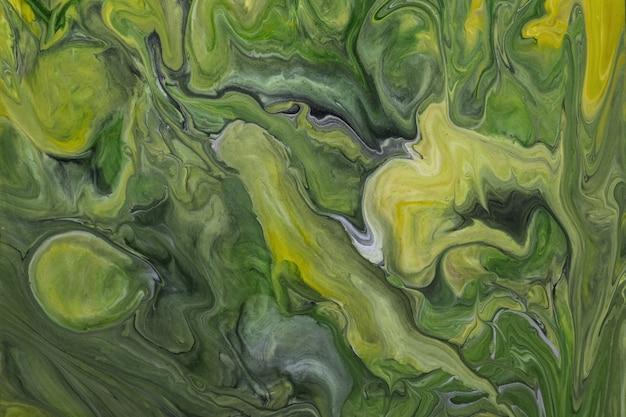 Dunkelgrüne und olivgrüne farben des abstrakten fließenden kunsthintergrunds. flüssiger marmor. acrylmalerei auf leinwand mit farbverlauf und spritzer