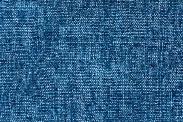 Dunkelgrüner garn-textilhintergrund der nahaufnahme und strukturierter, blauer cooton hintergrund