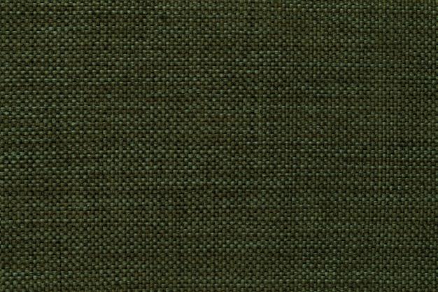 Dunkelgrünes dichtes gesponnenes absackgewebe, nahaufnahme.