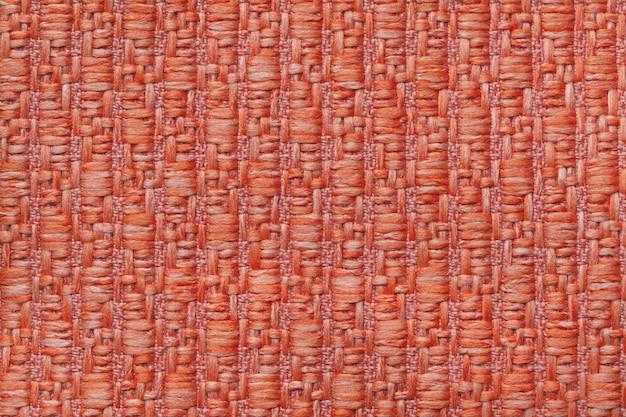 Dunkelorange gestrickter wollener hintergrund mit einem muster aus weichem, flauschigem stoff
