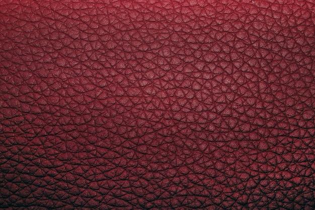 Dunkelrote textur aus echtem leder