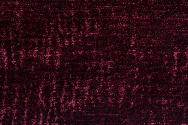 Dunkelroter flaumiger hintergrund des weichen, flaumigen stoffes, beschaffenheit der textilnahaufnahme