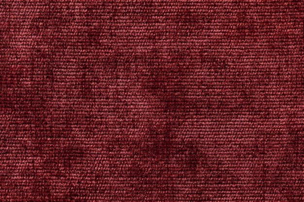 Dunkelroter hintergrund aus weichem textilmaterial