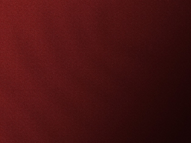 Dunkelroter texturhintergrund mit blattschatten