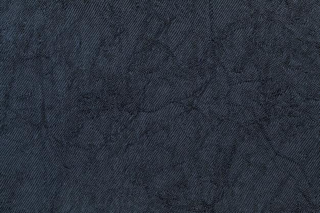 Dunkelvioletter hintergrund aus textilmaterial. stoff mit natürlicher textur