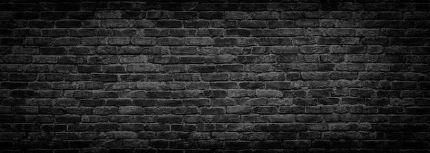 Dunkle backsteinmauer, textur aus schwarzen steinblöcken, hochauflösendes panorama