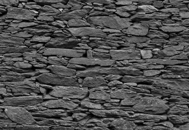 Dunkle graue steine stuck textur