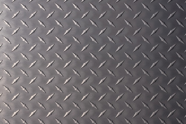Dunkle metallplatte als hintergrund. stahlstruktur mit einem rautenmuster.