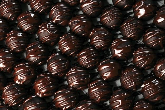 Dunkle schokolade des runden schokoladensüßigkeit dunklen hintergrundluxusdesserts handgemacht