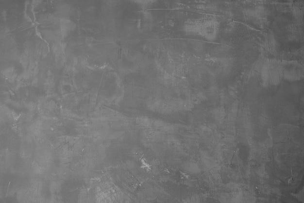 Dunkle und graue zementwand und betonstruktur