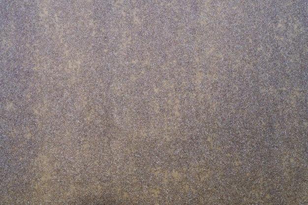 Dunkler abstrakter hintergrund mit goldglitter-splatter-textur