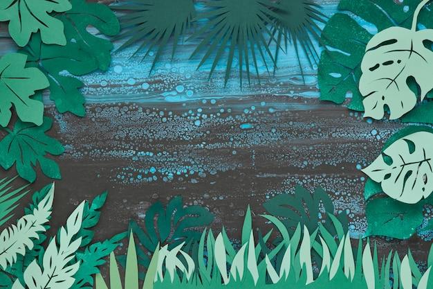 Dunkler blumenhintergrund mit tropischen papierblättern