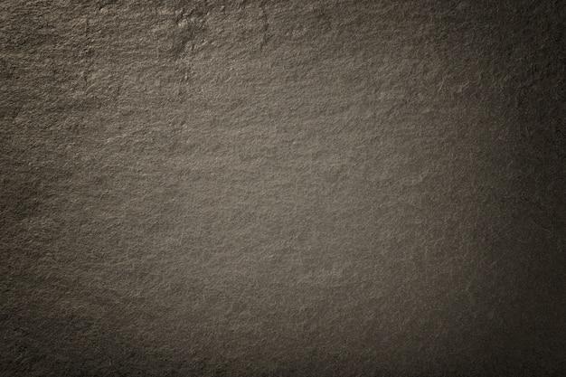 Dunkler bronzehintergrund des natürlichen schiefers