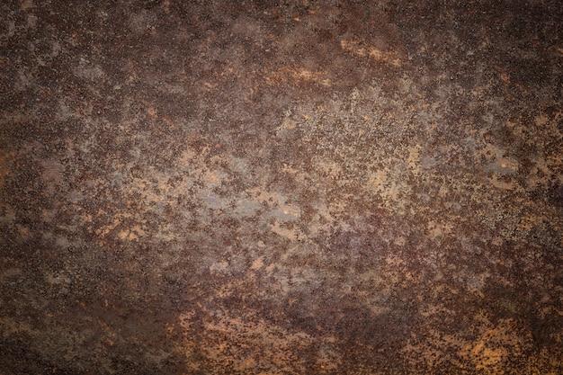 Dunkler getragener rostiger metallbeschaffenheitshintergrund. vintage-effekt.