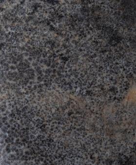 Dunkler natursteinhintergrund, die beschaffenheit des steins.
