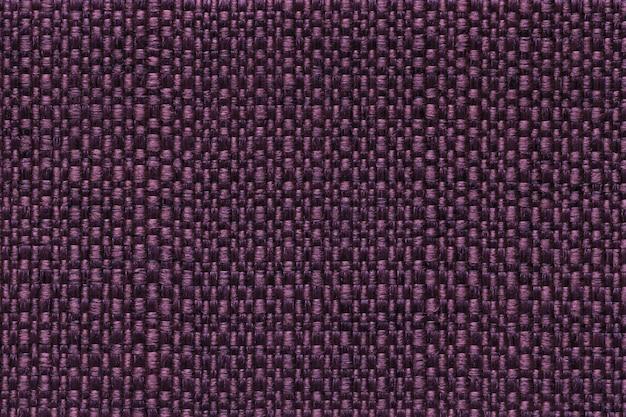 Dunkler purpurroter textilhintergrund mit kariertem muster