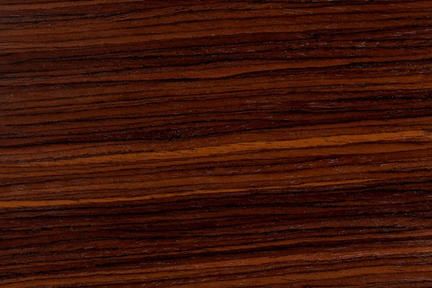 Dunkler rosenholzhintergrund, natürliche holzstruktur mit mustern. extrem hochauflösendes foto.
